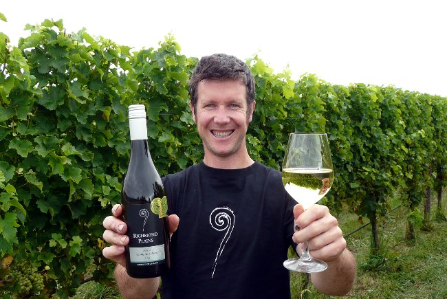 The winning Richmond Plains wine being displayed by wine maker