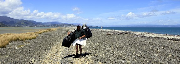 beach cleaner on Nelson's Boulder Banks returns laden with rubbish bags