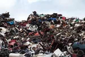 Scrap yard showing pile of car bodies