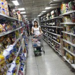 Woman in supermarket with shopping trollwy